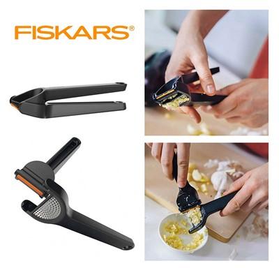 Пресс для чеснока cо скребком FISKARS